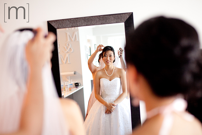 a photo of a bride in the mirror at a wedding at arcadian loft toronto