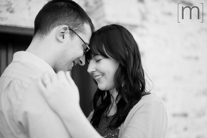 a photo of a couple snuggling at an engagement shoot in brighton ontari