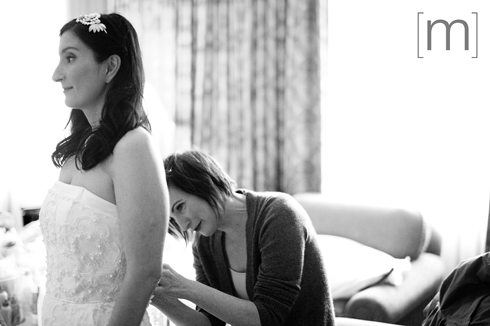 a photo of a bride getting ready at a wedding at king edward hotel toronto