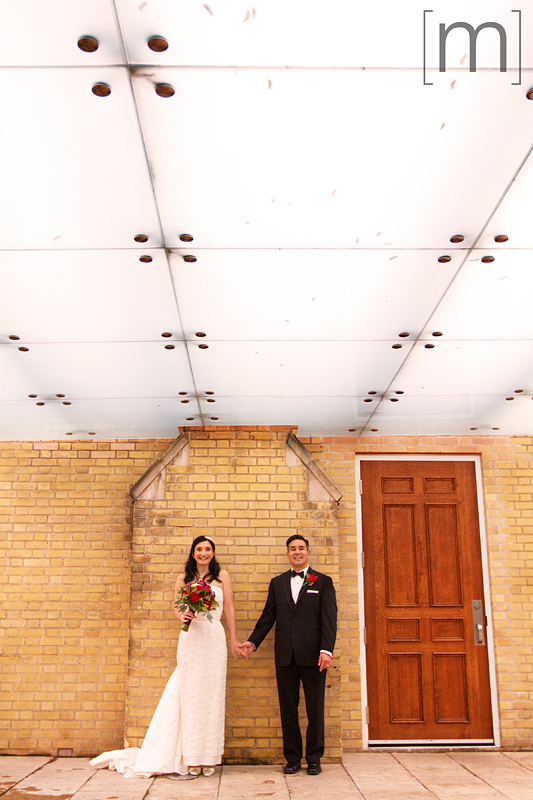 a photo of a couple holding hands at a wedding at st james cathedral centre toronto