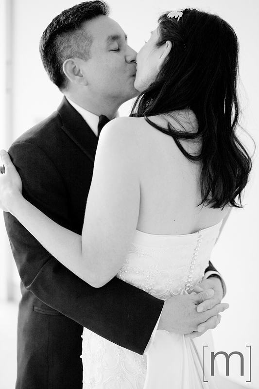 a photo of a couple kissing at a wedding at st james cathedral centre toronto
