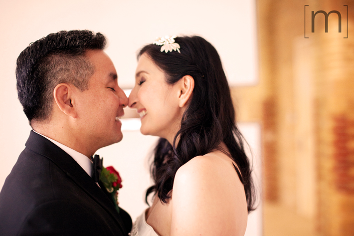 a photo of a couple cuddling at a wedding at st james cathedral centre toronto