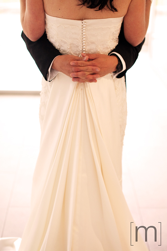 a photo of a wedding dress detail at st james cathedral centre toronto