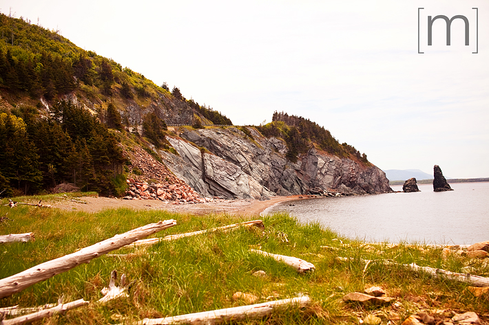 a travel photo of a rocky cliff in cape breton nova scotia