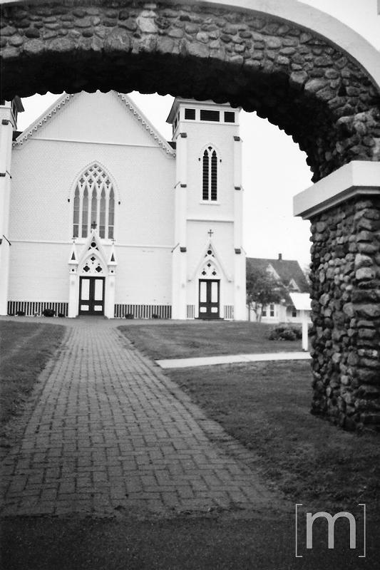 a travel photo of a church walkway in nova scotia