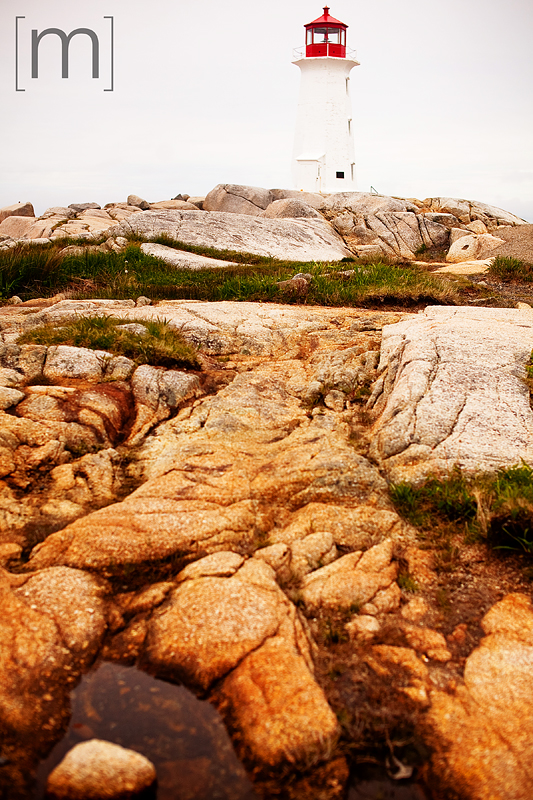 a travel photo of peggys cove lighthouse nova scotia