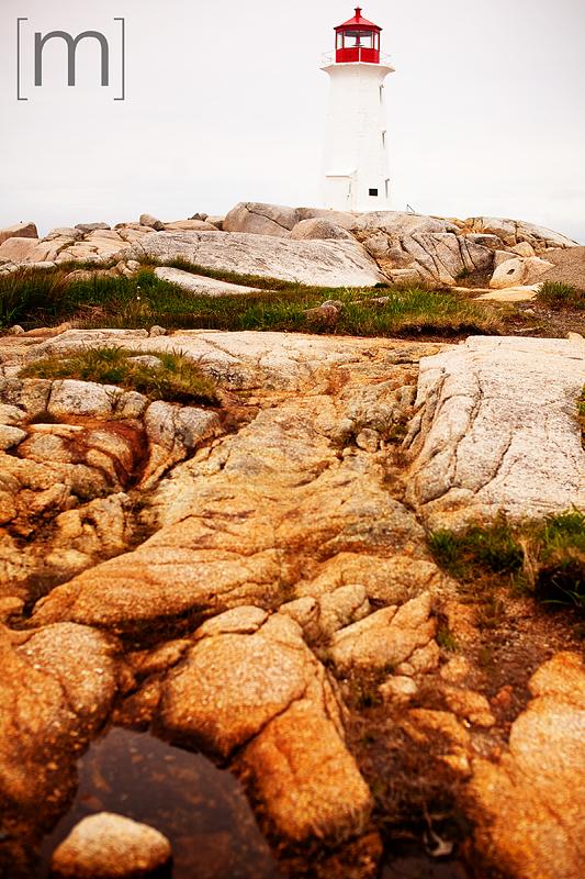 a travel photo of peggys cove lighthouse nova scotia