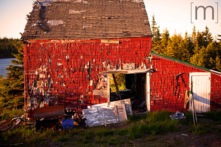 a travel photo of a rotting barn at sunset in nova scotia