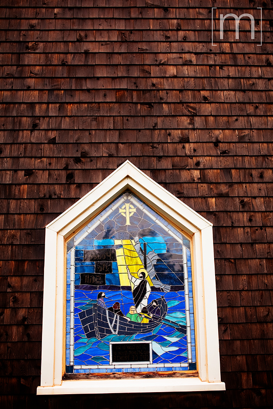 a travel photo of a stained glass window at a church in nova scotia