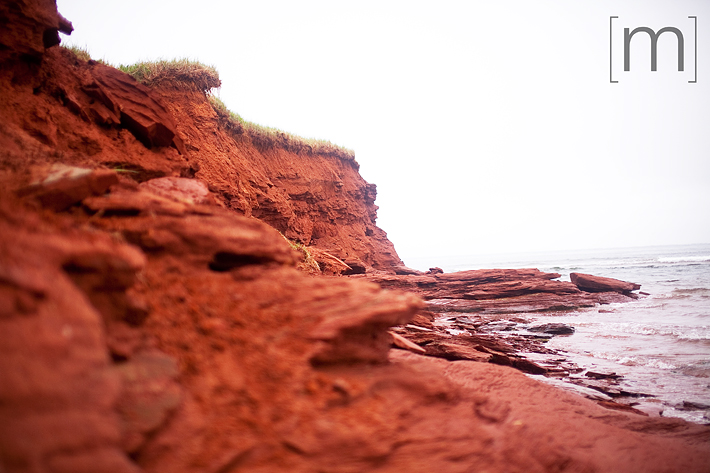 a travel photo of the red sands beach in pei