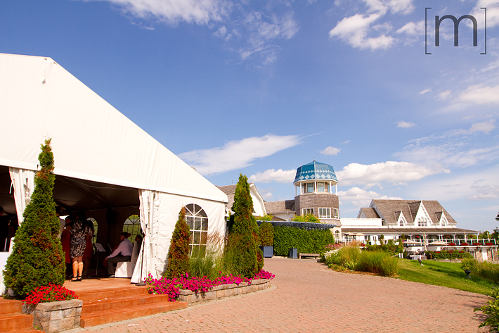 a photo of a tent at a wedding ceremony at angus glen golf club markham
