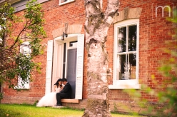 a photo of a couple sitting and cuddling at a wedding at angus glen golf club markham