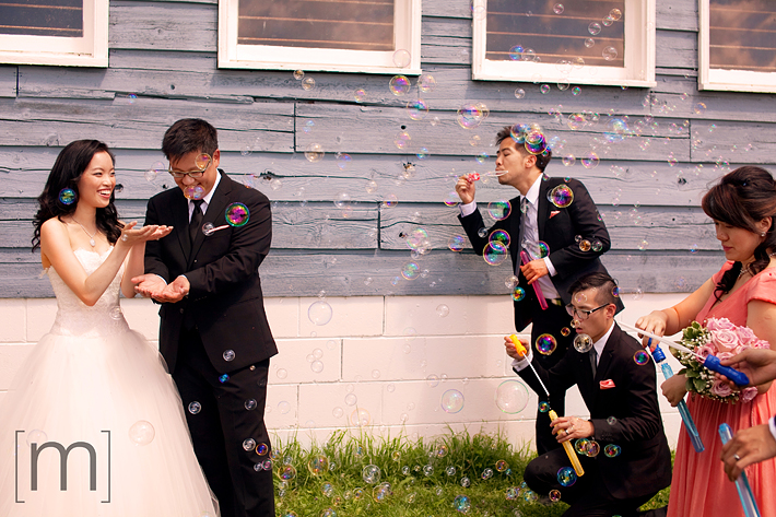 a photo of a couple surrounded by bubbles at a wedding at angus glen golf club markham