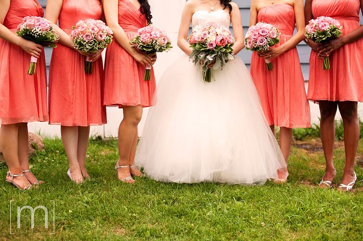 a photo of the bridesmaid dresses and flowers at a wedding at angus glen golf club markham