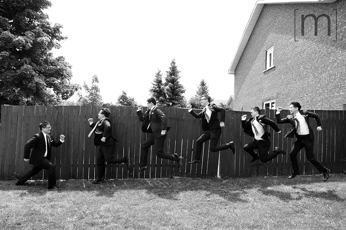a funny photo of the groomsmen at a wedding at angus glen golf club markham