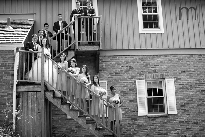 a photo of the wedding party on a staircase at a wedding at angus glen golf club markham