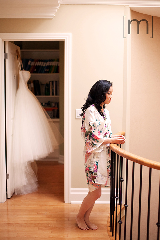 a photo of a bride getting ready at a wedding at angus glen golf club markham