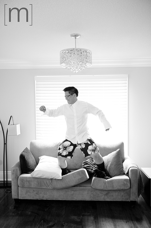 a photo of the groom jumping on the couch in his boxers at a wedding at angus glen golf club markham