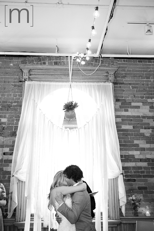 a photo of ceremony first kiss at a wedding at the gladstone hotel toronto