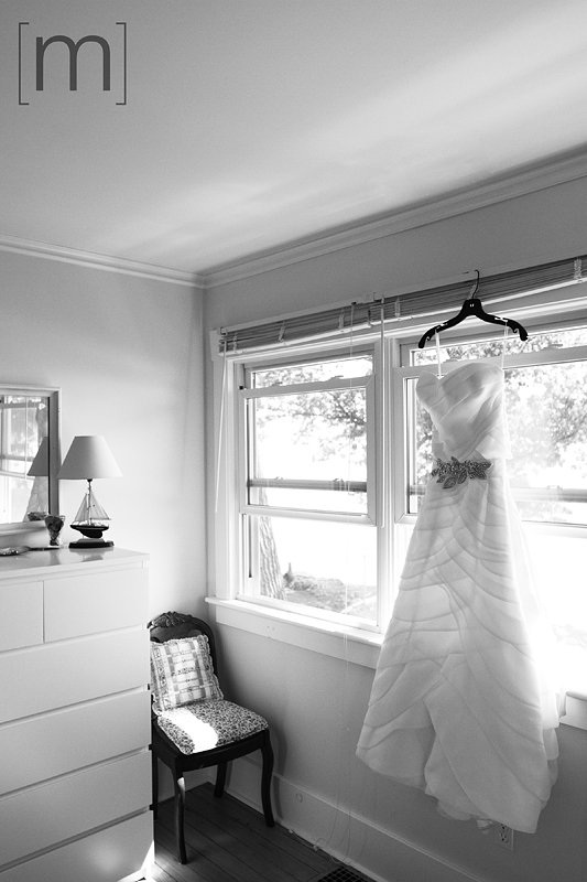 photo of a bridal dress hanging at at a wedding at buffalo canoe club fort erie
