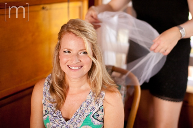 photo of a bride getting her hair done at a wedding at buffalo canoe club fort erie