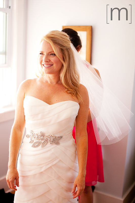 a photo of a bride getting ready at a wedding at buffalo canoe club fort erie