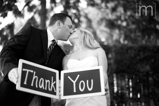 a photo of a couple with a thank you sign at a wedding at buffalo canoe club fort erie