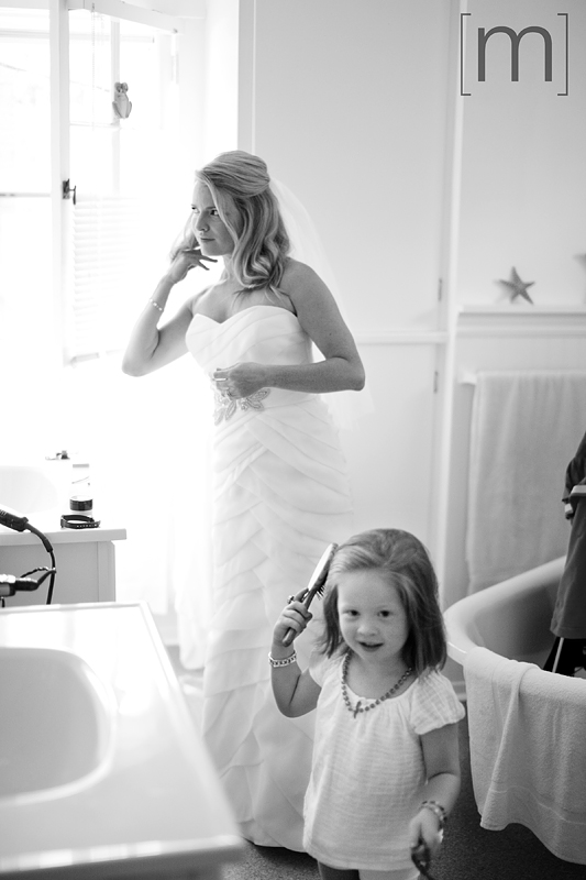 a photo of a cute girl brushing her hair at a wedding at buffalo canoe club fort erie