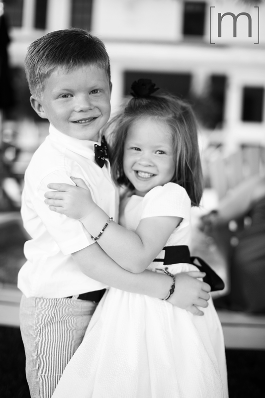 a photo of cute kids hugging at a wedding at buffalo canoe club fort erie