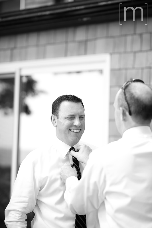 a photo of the groom getting ready at a wedding at buffalo canoe club fort erie