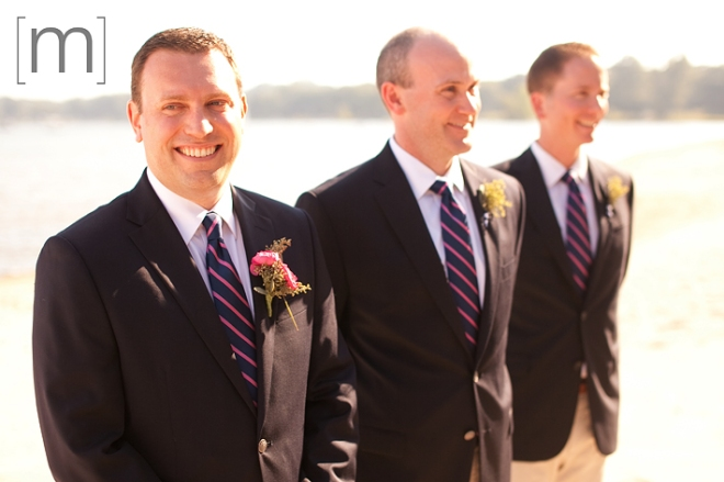 a photo of the groom waiting at a beach ceremony at a wedding at buffalo canoe club fort erie