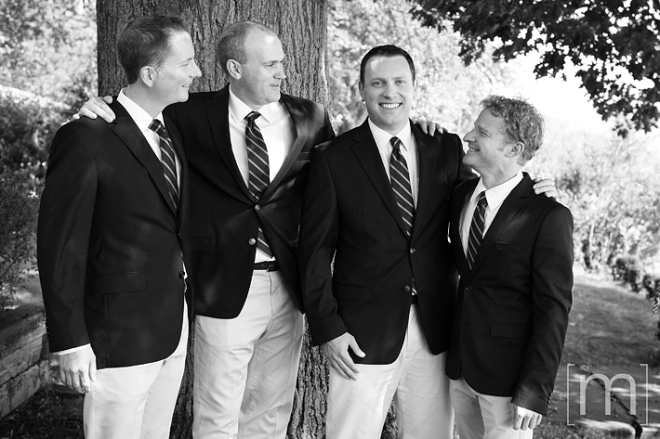a photo of the groomsmen at a wedding at buffalo canoe club fort erie