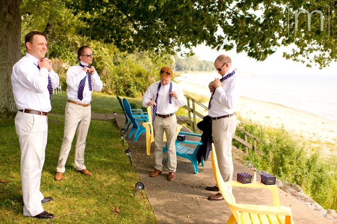 a photo of the groomsmen getting ready on the beach at a wedding at buffalo canoe club fort erie