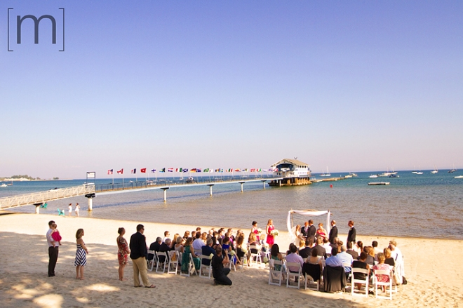 a photo of a beach ceremony at a wedding at buffalo canoe club fort erie