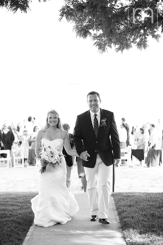 a photo of the happy couple at a beach ceremony at a wedding at buffalo canoe club fort erie