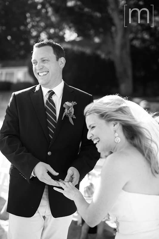 a photo of the ring exchange at a beach ceremony at a wedding at buffalo canoe club fort erie