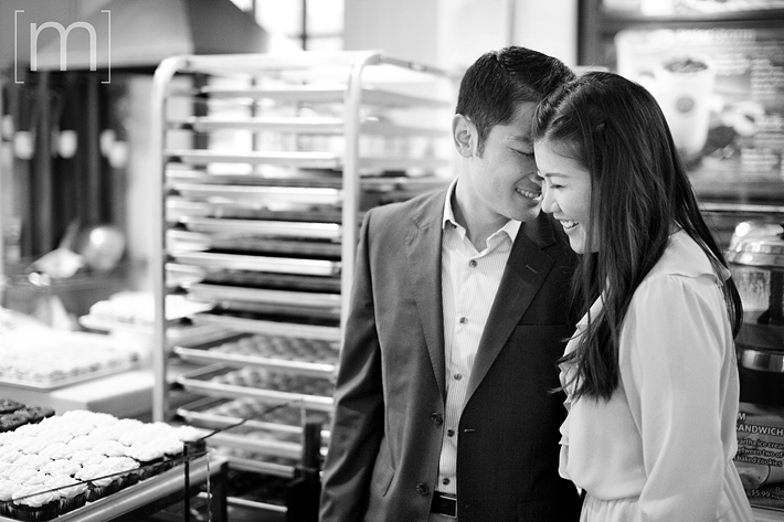 a photo of a couple laughing in a shop at a fall engagement shoot at unionville markham