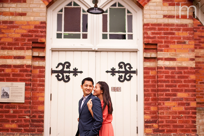 a photo of a couple laughing at a fall engagement shoot at unionville markham