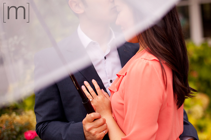 a photo of the ring under an umbrella at a fall engagement shoot at unionville markham