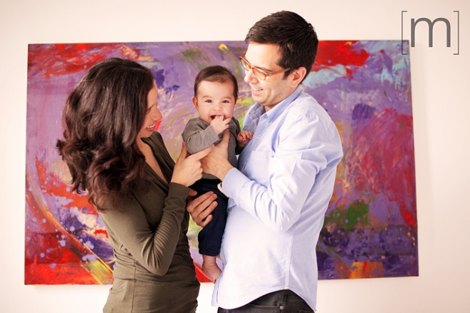 a family photo against a colourful painting in toronto
