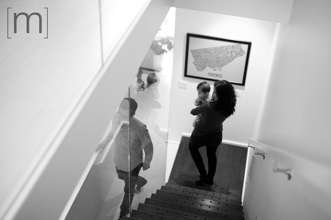 a family photo of the family walking down the stairs in toronto
